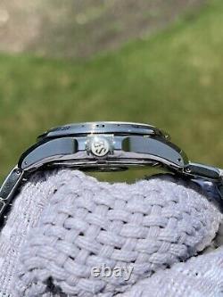 Grand Seiko SBGN005 Quartz GMT Sports Watch 39mm Steel
